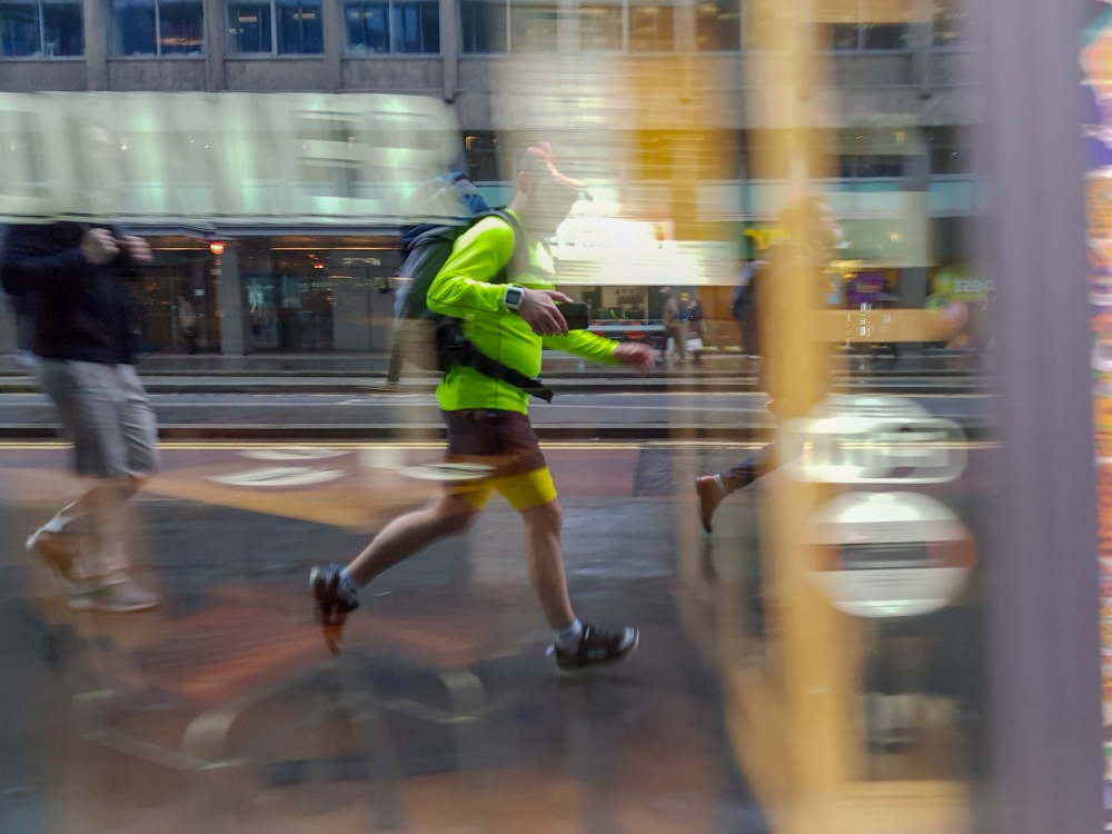Reflection of a runner in a shop window