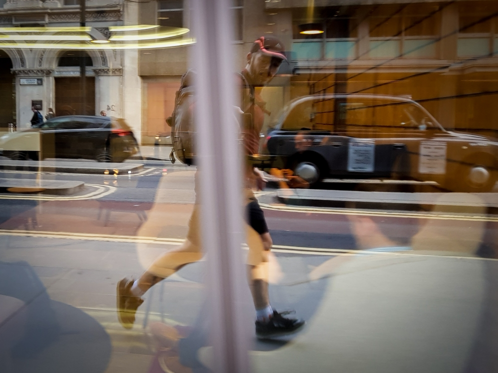 Runner reflected in a shop window